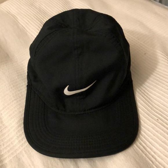 b6beed0b30782 Nike dri-fit feather light hat cap. M 5b9c50ceaaa5b8cb8b6e1e51. Other  Accessories ...